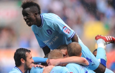 Gael Bigirimana celebrating with team mates.