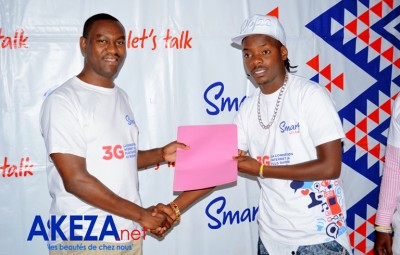 Handshake between Martin Nahamya , Sales Manager and singer Black G