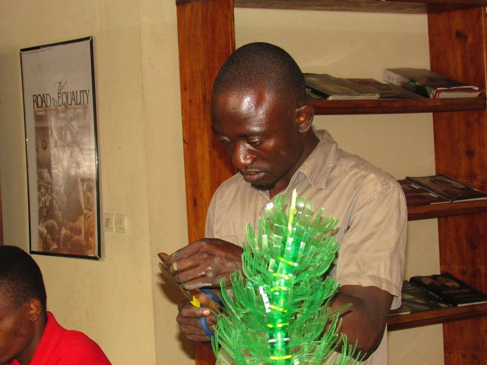 Gad Niyomukunzi, the man who is making flowers and decorative items from plastic flasks